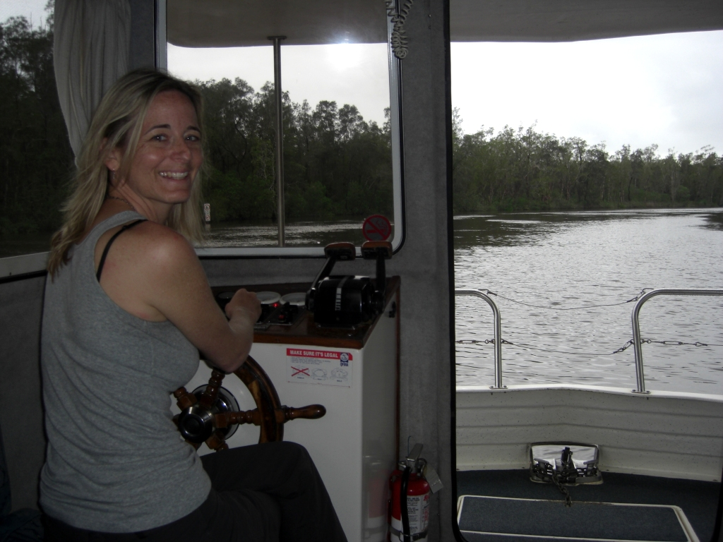 Barb brings the Happy Jack back down the Noosa River to base.