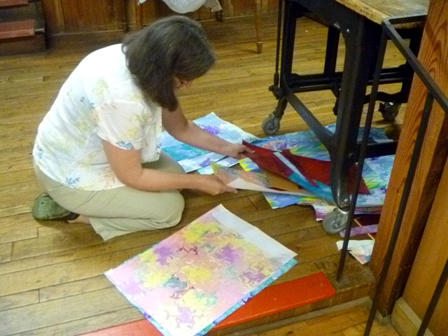 Gwen sorts through her stack of marbled papers