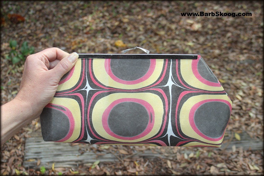 Front of clutch purse hand-sewn by Jeanie Joe using marbled fabric by Barb Skoog.