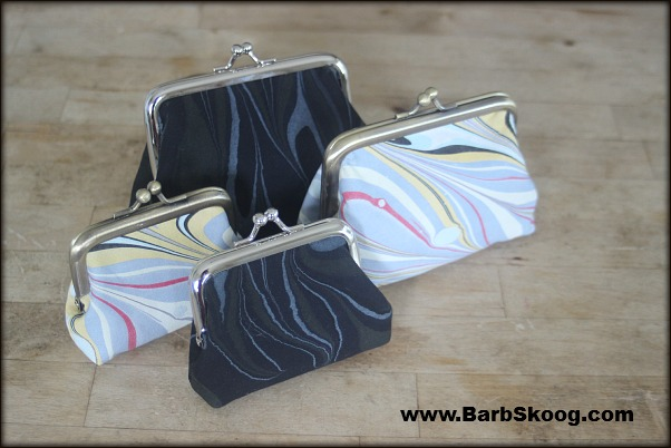 Large and small coin purses by marbler Barb Skoog.