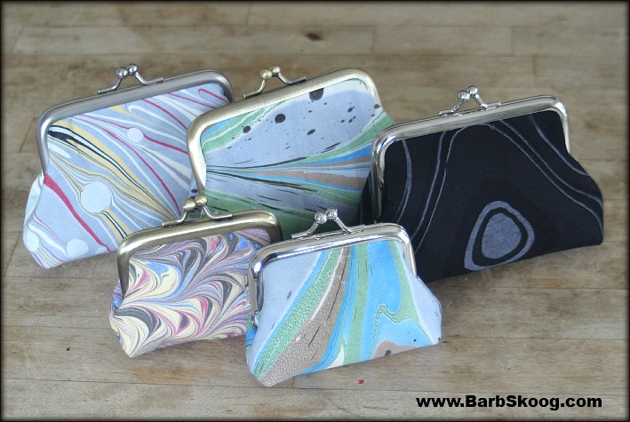 Large and small coin purses made with marbled fabric by Barb Skoog.