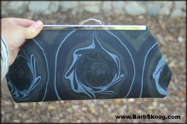 Clutch made with marbled fabric by Barb Skoog.